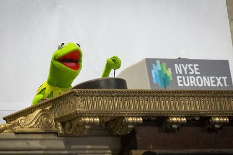 Muppet Kermit the Frog rings the opening bell at the New York Stock Exchange March 17, 2014. REUTERS/Brendan McDermid