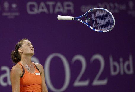 Agnieszka Radwanska of Poland throws her racket during her WTA Tour Championships tennis match against Victoria Azarenka of Belarus in Doha