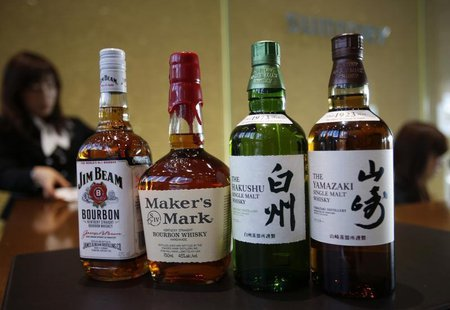 Bottles of Suntory Holding's Yamazaki (R) and Hakushu (2nd R) whiskies are displayed with Beam Inc's Jim Beam (L) and Maker's Mark bourbon a