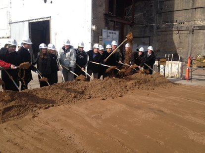 Titletown Brewing Company leaders and city officials break ground on the brewery's downtown Green Bay expansion, March 18, 2014. (Photo from: FOX 11).