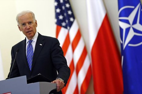 U.S. Vice President Joe Biden addresses to media after meeting Polish President Bronislaw Komorowski in Warsaw March 18, 2014. REUTERS/Kacpe