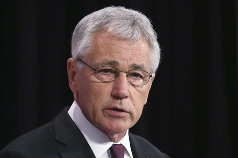 U.S. Secretary of Defense Chuck Hagel addresses a news conference during a NATO defence ministers meeting at the Alliance headquarters in Br