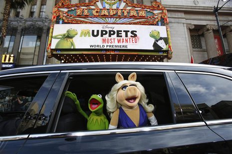 "The characters of Kermit and Miss Piggy arrive at the premiere of ""Muppets Most Wanted"" in Hollywood, California in this file photo taken Ma"