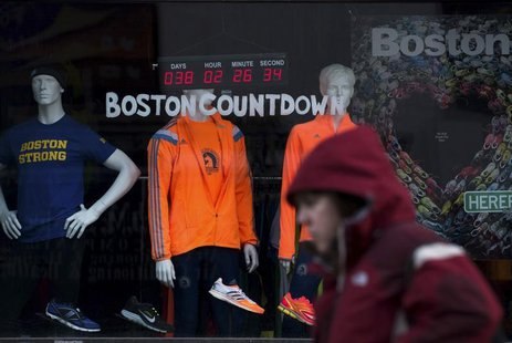 A digital clock on an athletic store front near the finish of the Boston Marathon, counts down the time to the 118th running of the Boston M