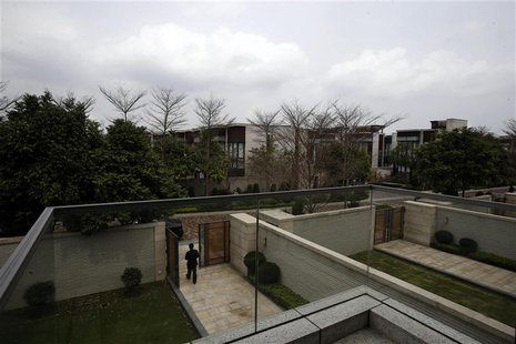 A property agent walks out of a house for sale by a mainland Chinese inside a luxury estate in Hong Kong in this March 18, 2014 file photo.