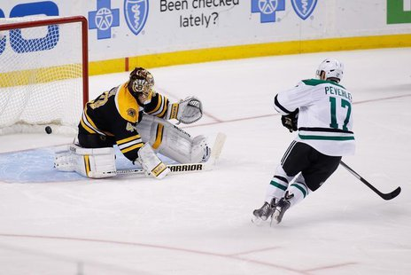 Nov 5, 2013; Boston, MA, USA; Dallas Stars center Rich Peverley (17) scores a goal on Boston Bruins goalie Tuukka Rask (40) during the shoot