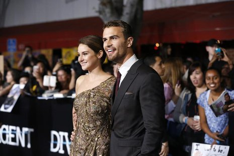 "Cast members Shailene Woodley and Theo James pose at the premiere of ""Divergent"" in Los Angeles, California, March 18, 2014. REUTERS/Mario A"