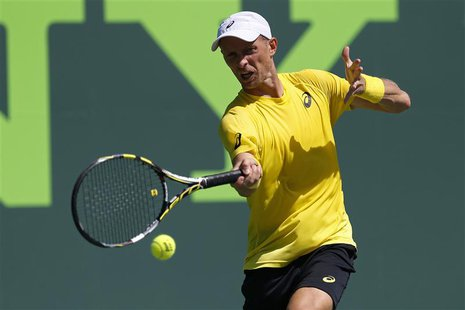 Mar 19, 2014; Miami, FL, USA; Nikolay Davydenko hits a forehand against Adrian Mannarino (not pictured) on day three of the Sony Open at Cra