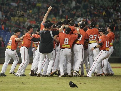 Australia's Canberra Cavalry players celebrate after defeating Taiwan's Uni-President 7-Eleven Lions 14-4 during their Asia Series 2013 base
