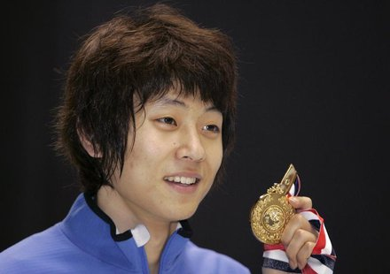 South Korea's Ahn Hyun-Soo poses with his gold medal after winning the men's 1500 metres event of the ISU World Cup Short Track in Kobe, wes