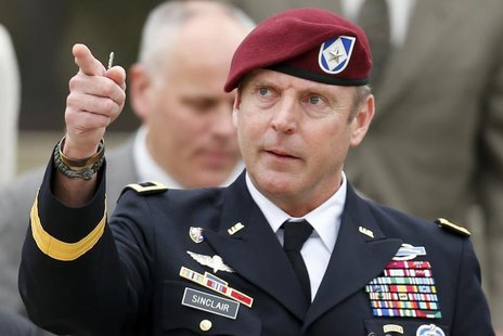 U.S. Army Brigadier General Jeffrey Sinclair gestures as he leaves the courthouse during his court-martial at Fort Bragg in Fayetteville, No