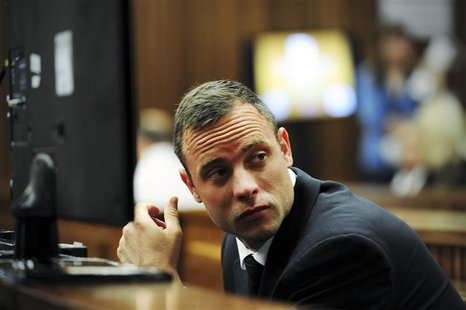 Olympic and Paralympic track star Oscar Pistorius sits in the dock during court proceedings at the North Gauteng High Court in Pretoria Marc