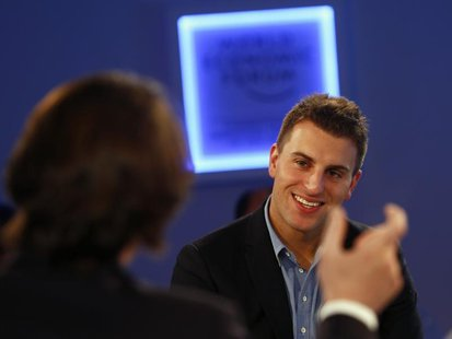 Brian Chesky, Chief Executive Officer of Airbnb smiles during a session at the annual meeting of the World Economic Forum (WEF) in Davos Jan