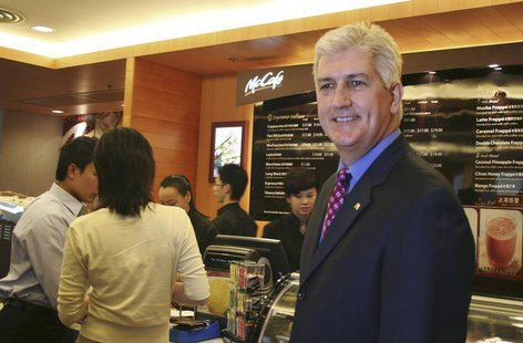 Tim Fenton, president of McDonald's Asia-Pacific, Middle East and Africa unit, poses at a McCafe restaurant in Hong Kong November 7, 2006. R