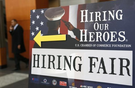 A sign points the way for military personnel, veterans and military spouses attending the Hiring Our Heroes job fair in Washington January 1