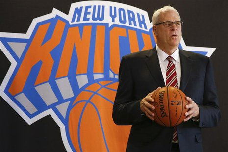 Phil Jackson poses during a news conference announcing him as the team president of the New York Knicks basketball team at Madison Square Ga