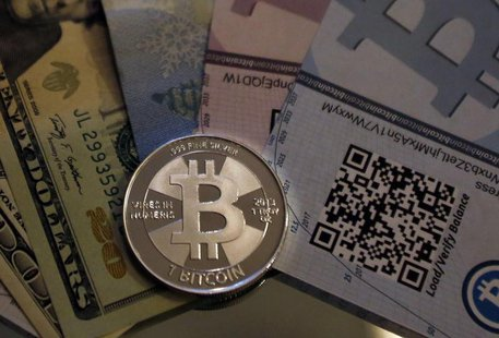 One of Bitcoin enthusiast Mike Caldwell's coins in this photo illustration at his office in Sandy, Utah, September 17, 2013. REUTERS/Jim Urq