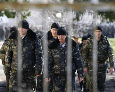 Ukrainian soldiers walk inside a military base in Perevalnoye, near the Crimean city of Simferopol, March 21, 2014. REUTERS/Shamil Zhumatov