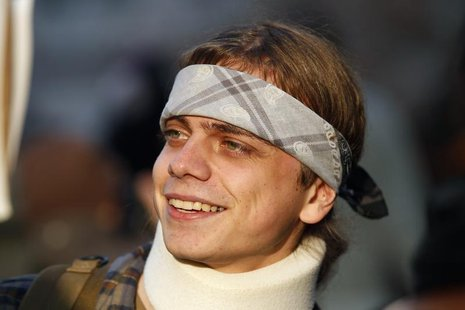 Marine veteran Scott Olsen, who suffered a head injury at the October 25 Occupy Oakland protest, smiles as he takes part in the Occupy movem