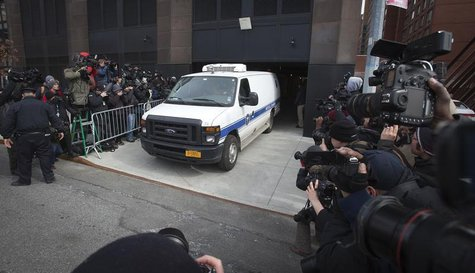 A New York City Medical Examiner van leaves the apartment building of designer L'Wren Scott in the Manhattan borough of New York March 17, 2