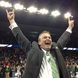 NDSU Head Coach Saul Phillips celebrates his team's 80-75 OT upset victory over the University of Oklahoma.