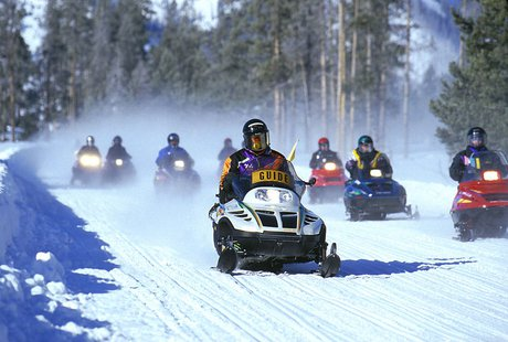 A snowmobile tour at Yellowstone National Park By (NPS Photo), uploaded by en:User:Great Scott. (http://en.wikipedia.org/wiki/Image:Snowmobiles.jpg) [Public domain], via Wikimedia Commons