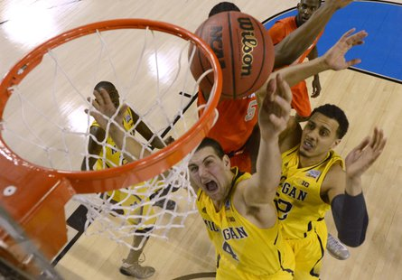 Michigan going for the dunk. REUTERS/Daniel J. Beauvais.