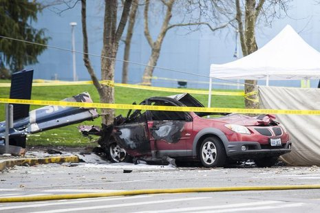 Wreckage is pictured where a television news helicopter crashed near the Space Needle in Seattle, Washington March 18, 2014. REUTERS/David R