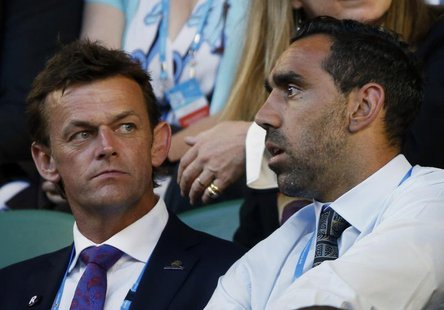 Australian cricketer Adam Gilchrist sits with Australian Football League (AFL) player Adam Goodes in the spectator stands ahead of the men's