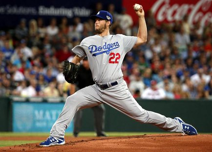 Los Angeles Dodgers pitcher Clayton Kershaw delivers a pitch against the Arizona Diamondbacks during the opening innings of the opening game