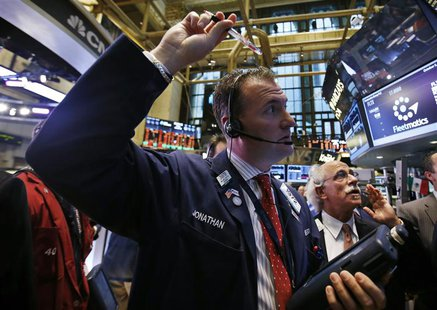 Traders work on the floor of the New York Stock Exchange at the opening of the trading session in New York October 5, 2012. REUTERS/Mike Seg
