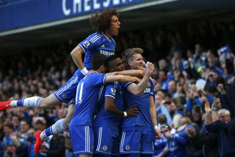 Chelsea's Andre Schurrle (R) celebrates with team mates after scoring a goal against Arsenal during their English Premier League soccer matc
