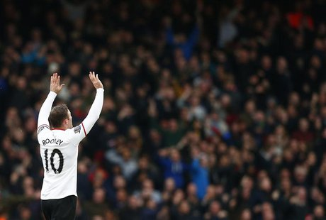 Manchester United's Wayne Rooney celebrates after scoring a goal against West Ham United during their English Premier League soccer match at