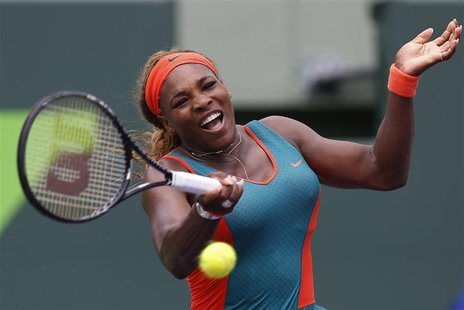 Mar 22, 2014; Miami, FL, USA; Serena Williams hits a forehand against Caroline Garcia (not pictured) on day six of the Sony Open at Crandon