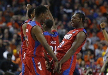 Mar 22, 2014; Buffalo, NY, USA; Dayton Flyers forward Dyshawn Pierre (21) and Dayton Flyers forward Kendall Pollard (22) celebrate beating t