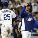 October 14, 2013; Los Angeles, CA, USA; Los Angeles Dodgers left fielder Carl Crawford (25) celebrates with manager Don Mattingly (8) the 3-