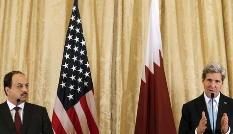U.S. Secretary of State John Kerry (R) and Qatar Foreign Minister Khaled Al-Attiyah attend a news conference after a meeting at the U.S. emb
