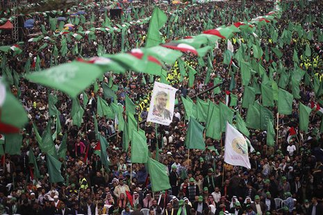 Palestinian Hamas supporters take part in a Hamas rally marking the anniversary of the death of its leaders killed by Israel, in Gaza City M