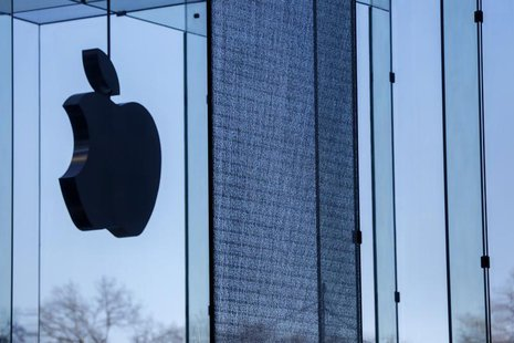 A shattered large glass panel, part of Apple's cube store on Fifth Avenue, damaged from the results of the snowstorm on Tuesday is seen in N