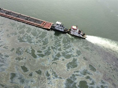 A barge loaded with marine fuel oil sits partially submerged in the Houston Ship Channel in this U.S. Coast Guard picture taken March 22, 20