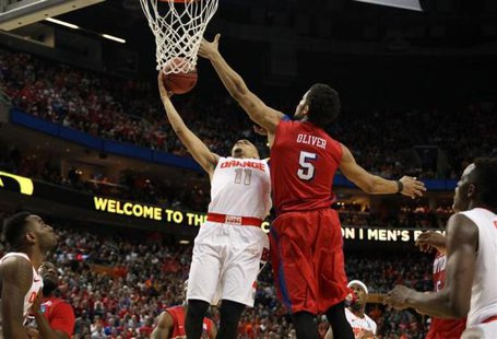 Syracuse Orange guard Tyler Ennis (11) misses a shot late as Dayton Flyers forward Devin Oliver (5) defends in the second half of a men's college basketball game during the third round of the 2014 NCAA Tournament at First Niagara Center. Timothy T. Ludwig-USA TODAY Sports