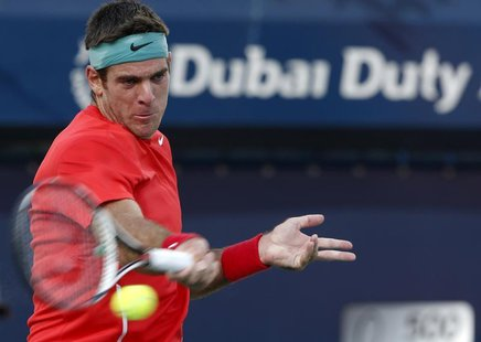 Juan Martin Del Potro of Argentina returns the ball to Somdev Devvarman of India during their men's singles match at the ATP Dubai Tennis Ch