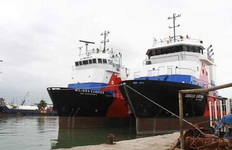 Two ships of Oceanografia are moored at a dock in the port in Ciudad del Carmen March 7, 2014. REUTERS/Adrian Virgen