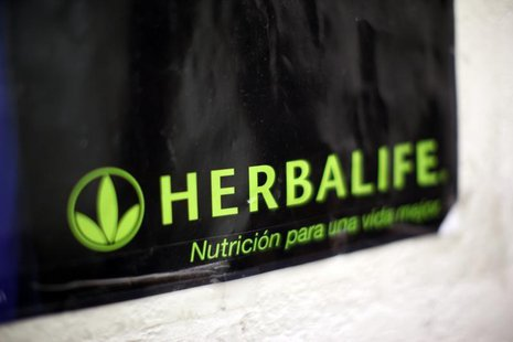 A Herbalife logo is shown on a poster at a clinic in the Mission District in San Francisco, California April 29, 2013. REUTERS/Robert Galbra