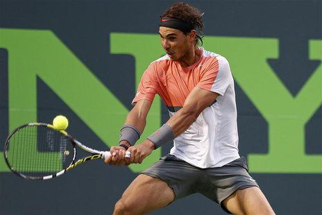 Rafael Nadal hits a backhand against Denis Istomin (not pictured) on day eight of the Sony Open at Crandon Tennis Center. Nadal won 6-1, 6-0