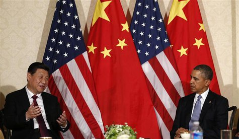 China's President Xi Jinping speaks during his meeting with U.S. President Barack Obama (R), on the sidelines of a nuclear security summit,