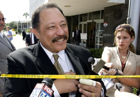 Judge Joe Brown, a television court judge, talks to the media outside the federal court in Ocala, Florida, April 24, 2008. REUTERS/Scott Aud