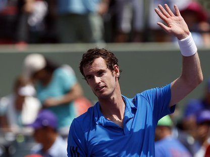 Mar 23, 2014; Miami, FL, USA; Andy Murray waves to the crowd after his match against Feliciano Lopez (not pictured) on day seven of the Sony