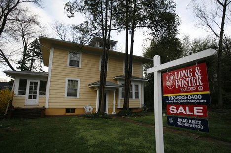 A house for sale is pictured in Alexandria, Virginia in this March 22, 2010 file photo. REUTERS/Molly Riley/Files