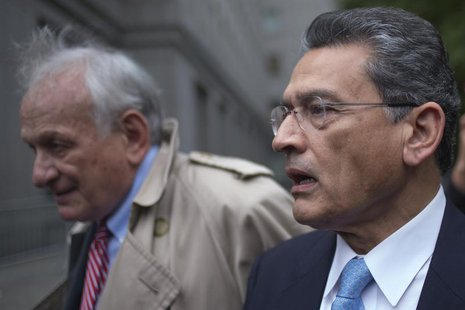 Former Goldman Sachs Group Inc board member Rajat Gupta leaves the U.S. District Court with his lawyer Gary Naftalis after he was sentenced